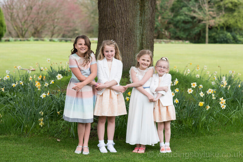 Girls in front of daffodils